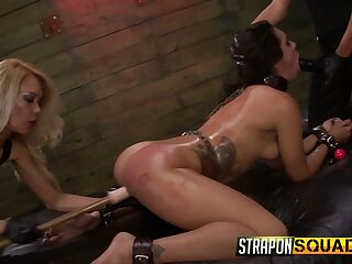 Two complete whores punish tied up bitch Ava Kelly in the BDSM room