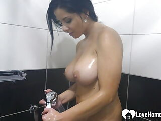 Desirable busty chick masturbates in the shower