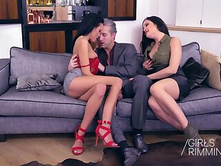 Two naughty babes give a rimjob and blowjob to one handsome boyfriend