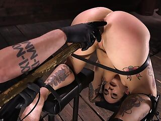 Tattooed bitch with juicy ass Joanna Angel gets punished in the dark BDSM room
