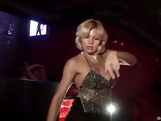 Sexy party girls dancing and shaking their asses at a club