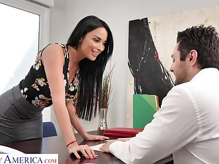 Femme fatale woman Anissa Kate offers herself sitting on the bosss table