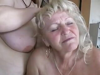 Pallid old blonde kneels down to suck huge boobs