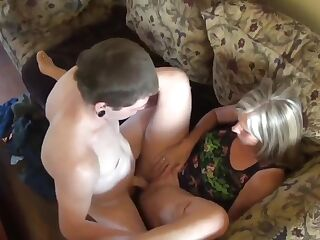 Sexy stepmom with big saggy tits helps her stepson to cum