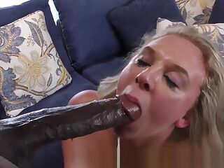Busty blonde gobbles and rides big black cock