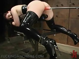 Fuckable Brunette Wears Latex Boots As She Gets Fucked By Fucking Machine