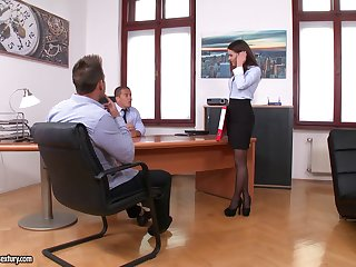 Naughty office slut enjoys pleasuring two stiff cocks