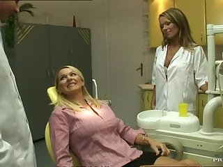 Hot Lesbian Dentist Fucks Her Patient And Gets Joined By Her Colleague