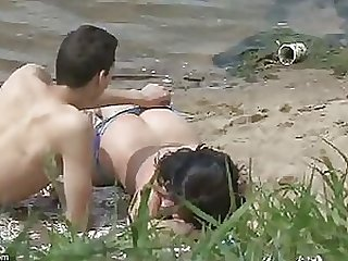 Horny Couple Caught By Voyeur Cam Having Sex On The Beach