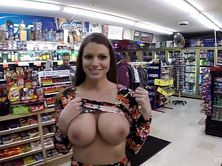 Impressive brunette is ready to flash with her tits in the supermarket