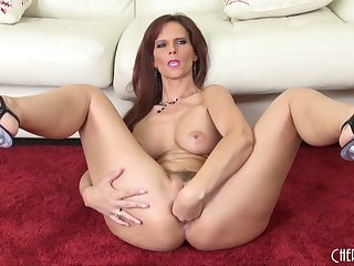 Purple dildo is ready to enter her shaved tunnel of love
