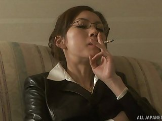 Smoking Japanese girl with glasses sucks her boss's cock
