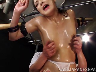 Slave girl is oiled up and tortured by a group of guys