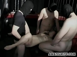 Slutty amateur woman gets gangbanged by a group of masked men
