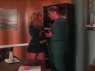 Hot vintage lesbian video of two cute blondes having fun in an office
