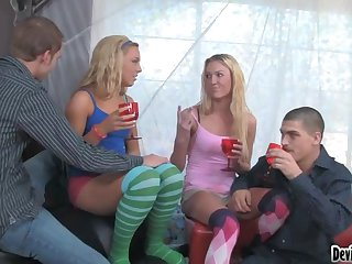 Two dudes are having a small party with their wifes
