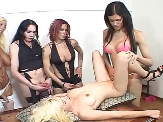 Sexy blonde girl gets gangbanged by four shemale hotties