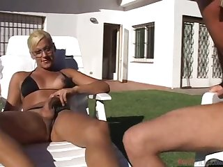 Kinky blonde tranny Ayelen has wild sex on the poolside