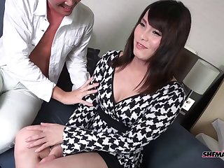 Dick sucking Asian tranny cutie sits down on his rod for anal