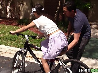 He teaches her to ride a bike then to ride his fat cock